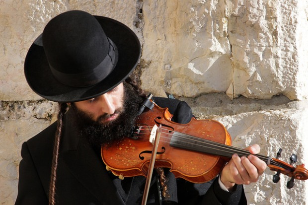 Man playing violin in Jerusalem-Old City by Steve Evans
